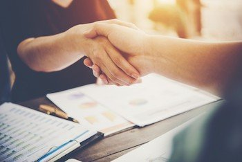 Consultant shaking hands with hiring of new employee